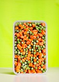 Frozen peas and carrots in container