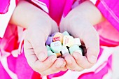 Girl holding heart candy with messages, Close-Up