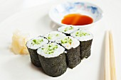 Maki sushi with cucumber, ginger and soy sauce