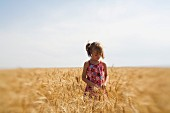 Girl Exploring Wheat Field