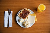 Toast with Jam, Hardboiled Egg, Roll, Cheese and Orange Juice for Breakfast