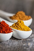 Three spoons of different spices (close-up)