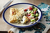 Cream cheese and pea strudel with Greek salad