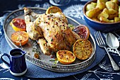 Roast chicken with glazed oranges and lemons