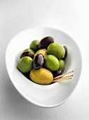 Mixed olives with toothpicks