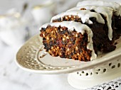 Gluten-free fruitcake with sugar glaze, partly sliced