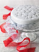 Gluten-free Christmas cake with a red ribbon