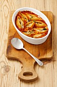 Pasta shells with mushroom and cheese filling in tomato sauce