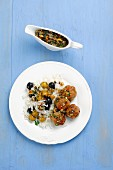 Pork meatballs with rice and olive sauce