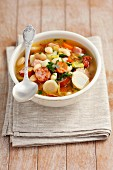 Vegetable soup with sausage, bacon and white beans