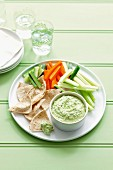 Vegetable batons with warm pea and feta dip and wholemeal flatbread