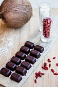 Filled chocolates with goji berries and coconut