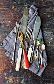 Vintage cutlery on a linen napkin