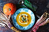 pumpkin soup for Halloween with indian corn
