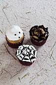 Three mini Halloween cupcakes on recycle paper surface