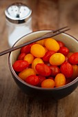 Bowl of fresh red and yellow grape tomato mix