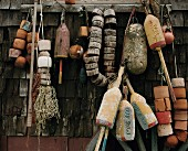 Fishing Nets and Flotation Devices Hanging on Side of Rustic Building