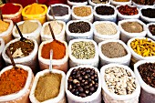 Sacks of spices on a market stall