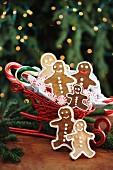 Gingerbread men in a sleigh-shaped basket
