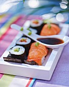 Nigiri and maki sushi with soy sauce