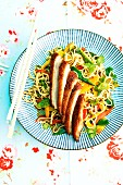 Fried duck breast with oriental fried noodles