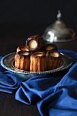 Canelés de Bordeaux (French sweet little treats) in silver bowl