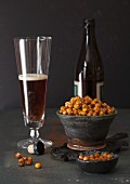 Roasted chickpeas with ginger, spices and sesame seeds and a glass of beer