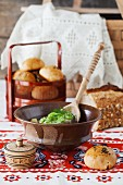 Russian fish soup with bread and dinner rolls