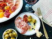 Antipasti with salami, olives and tomatoes