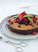 A truffle cake with summer berries