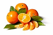 Mandarins (whole, halved and segmented) with leaves