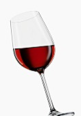 Tilted red wine glass