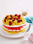 An ice cream cake with meringue and mango and raspberry sorbet