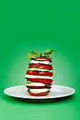 Tomato Caprese Salad Stack on Green Background