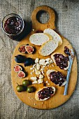 Figs and Bread with Fig Jam on Cutting Board, High Angle View