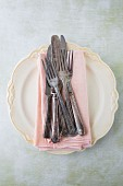 Pink Napkins and Silverware on Plate, High Angle View