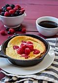 A Dutch pancake with raspberries