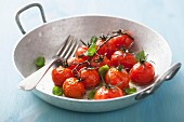 Roasted cherry tomatoes with basil