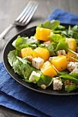 Rocket salad with pumpkin, feta and walnuts