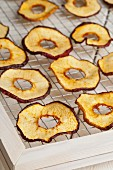 Dried apple rings on a drying rack