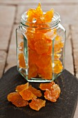 Candied orange pieces in a screw-top jar