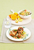 Barbecued drumsticks with orange couscous