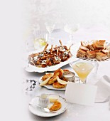 A festive buffet with lamb chops, sandwiches and crab cakes