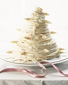A pyramid cake with white cream