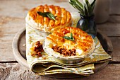 Puff pastry pies filled with minced poultry, sage and pepper