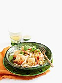 Stir-fried noodles with prawns, bean sprouts and coriander