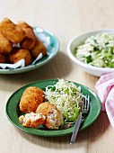 Salami and cheese croquettes with coleslaw