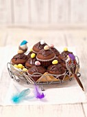 Chocolate muffins decorated with sugared eggs for Easter