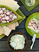 Cucumber salad, radish salad, crisp bread and slices of cheese