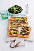 Puff pastry quiche with green asparagus